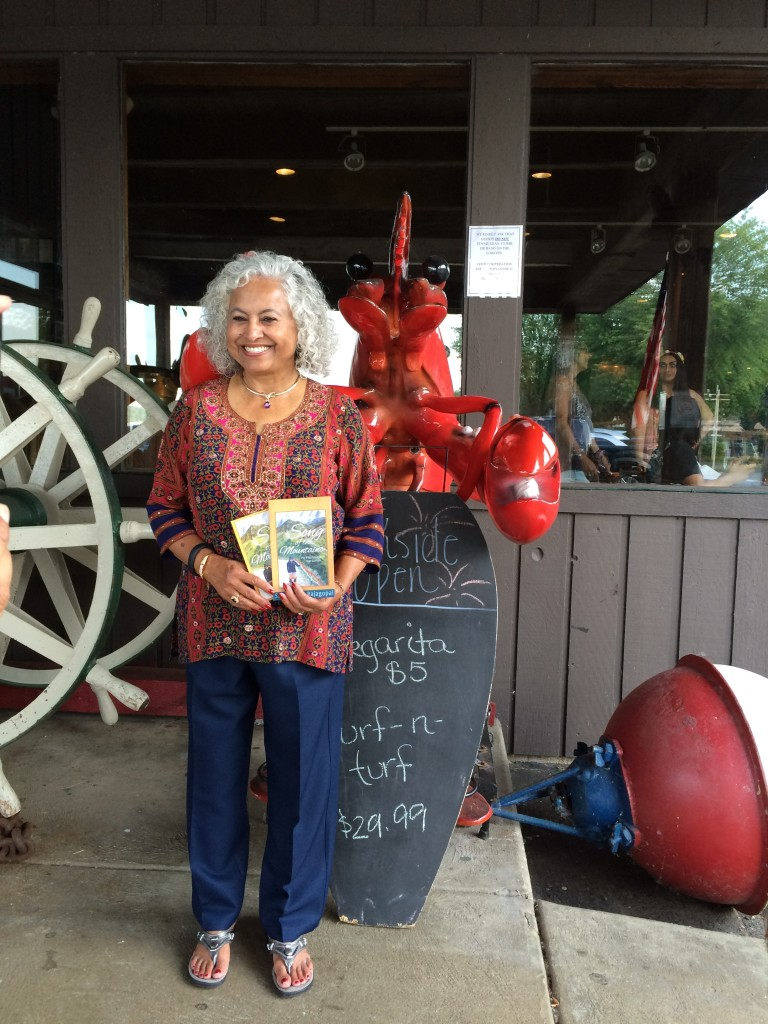 Author Shakuntala Rajagopal with her book Song of the Mountains at Port Edward book signing