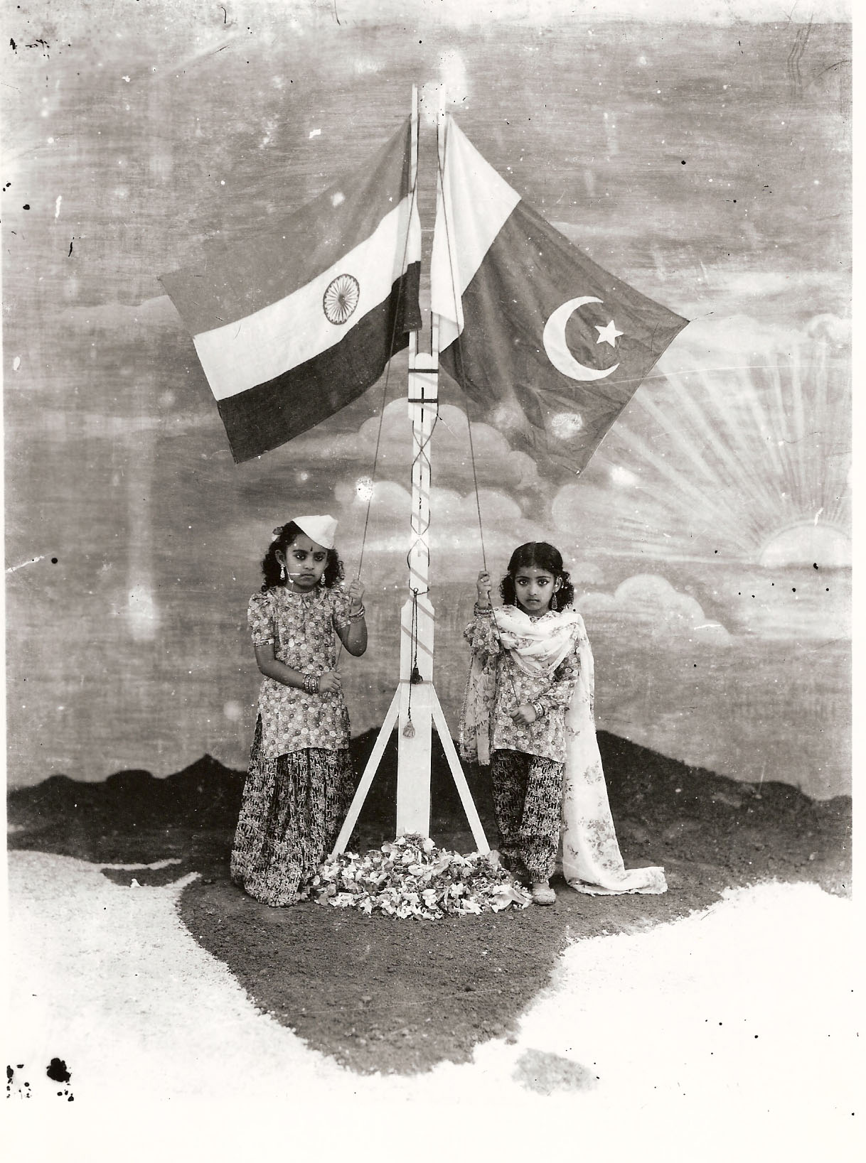 1947 Shaku holding Indian flag and Shanthi the Pakistan flag